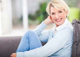 Middle-aged woman relaxing at home