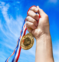 Athlete holding up gold medal