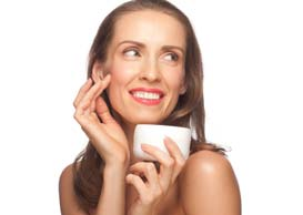 Middle Aged Woman Applying Facial Cream
