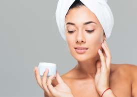 Woman applying skin care