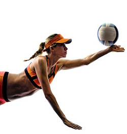 Professional volleyball player spiking ball