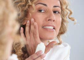 Woman applying retinol cream