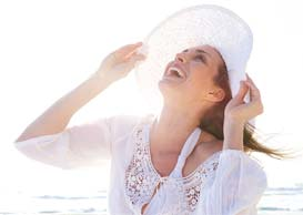 Woman smiling into the sun
