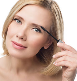 Woman applying fix gel to eyebrows