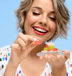 Woman eating gummy candy