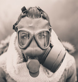 Woman wearing gas mask to protect herself from pollution