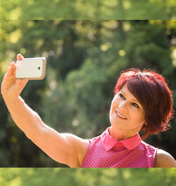 woman taking a selfie outside
