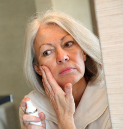 woman applying skin care products