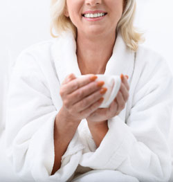 Peaceful woman sipping tea at spa